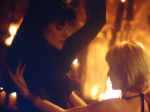 Lucy Lawless wallpaper with a fire and a fire entitled Sexy Dance