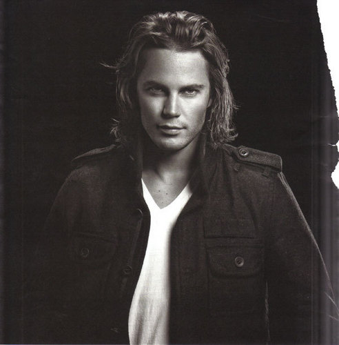 Friday Night Lights wallpaper possibly containing a pea jacket and a well dressed person called Tim Riggins (Taylor Kitsch)