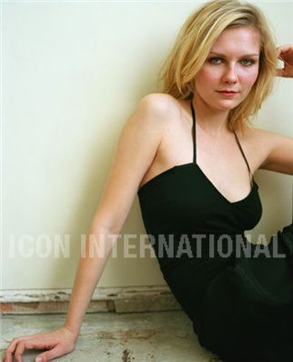 Kirsten Dunst wallpaper probably containing attractiveness, a bustier, and a portrait entitled Kirsten
