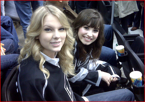 Demi Lovato wallpaper possibly containing a street entitled Demi Lovato & Taylor Swift at a Hockey Game