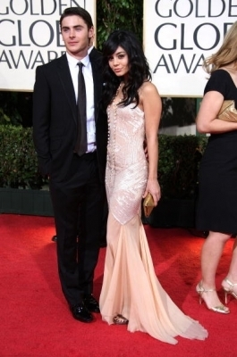 Zac Efron & Vanessa Hudgens wallpaper containing a bridesmaid, a dinner dress, and a business suit titled Zanessa @ 2009 Golden Globe Awards