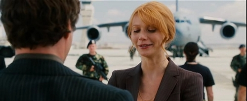 Gwyneth Paltrow wallpaper containing a business suit, a suit, and a well dressed person entitled Iron Man Screencaps