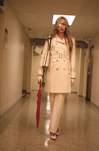 Kill Bill wallpaper containing a trench coat and a well dressed person entitled kill bill