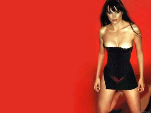 Lucy Lawless wallpaper probably with a bustier, attractiveness, and a leotard entitled Lucy Lawless