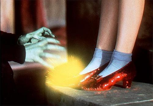 The wicked witch tries to steal the Ruby slippers