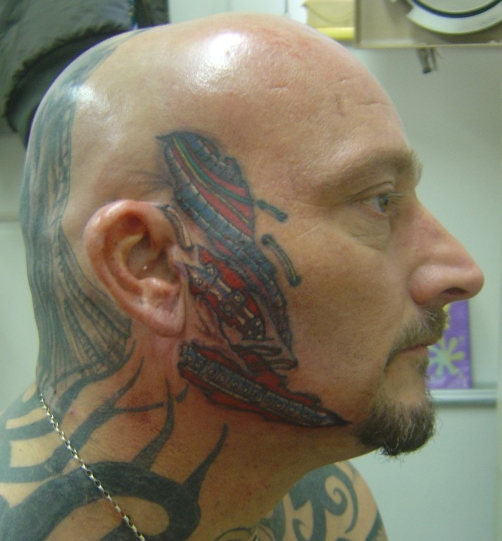 tattoo face. Bio mechanical face tattoo