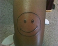 Dazed Smiley tattoo