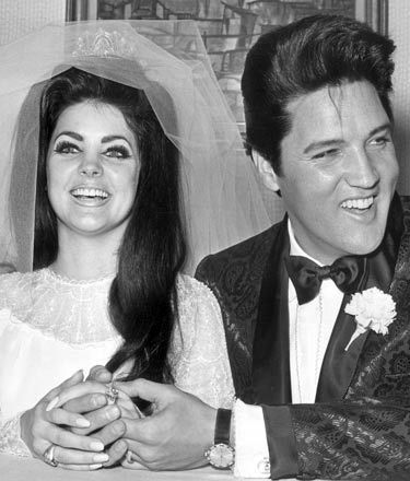 Elvis and Prescilla at their wedding