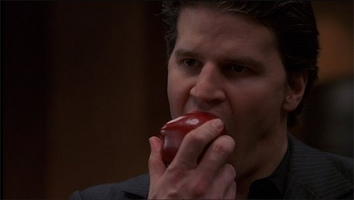 Angel eating an apple