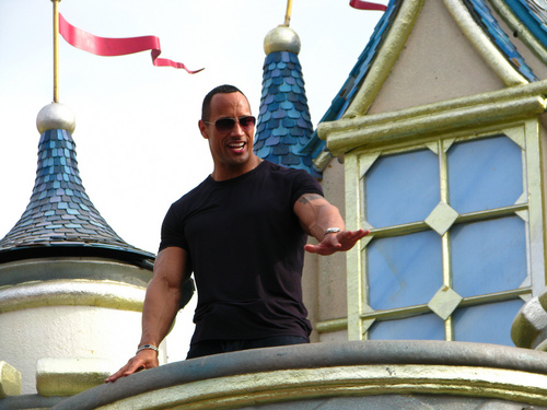 "Dwayne ""The Rock"" Johnson fondo de pantalla possibly containing a calle and a brownstone, piedra arenisca, color café rojizo entitled Dwayne At Disneyland (Hong Kong)."