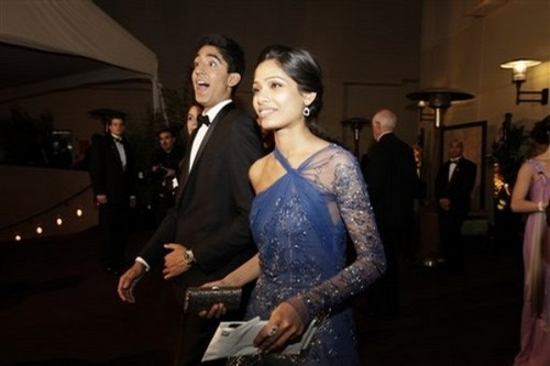Dev Patel achtergrond probably containing a well dressed person and an outerwear titled Dev Patel