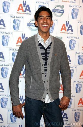 Dev Patel achtergrond with a cardigan, vest called Dev