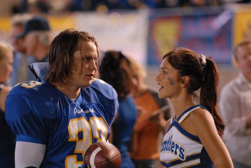Friday Night Lights wallpaper possibly with a basketball player and a dribbler entitled Tim & Lyla