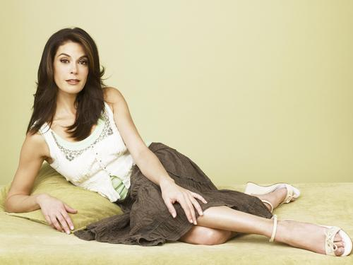 Desperate Housewives wallpaper possibly containing bare legs, hosiery, and a hip boot called Teri Hatcher
