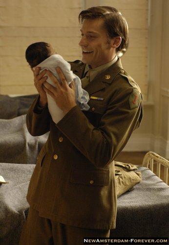 John Amsterdam with baby Omar
