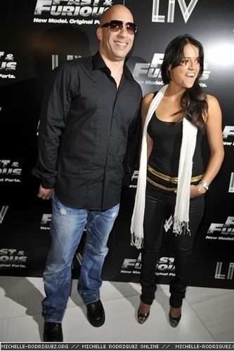 Michelle Rodriguez hình nền with long trousers and a well dressed person titled Michelle & Vin @ Fast & Furious Release - 2009
