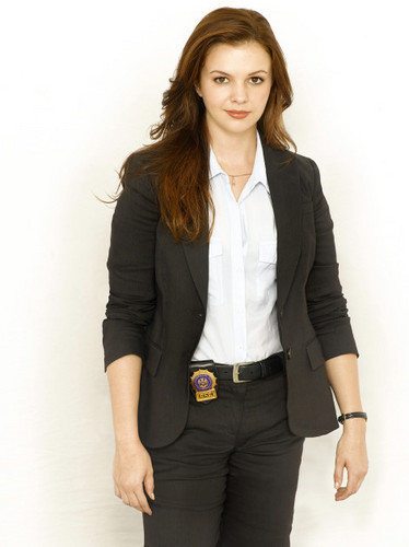 Amber Tamblyn wolpeyper containing a business suit, a suit, and a well dressed person entitled 'The Unusuals' Promo