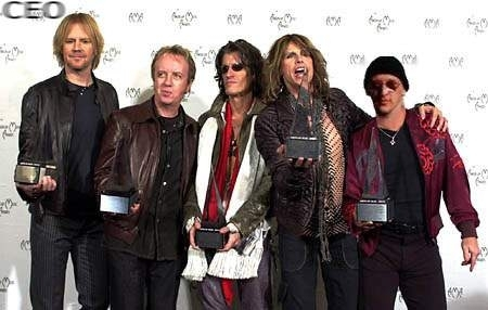 Aerosmith Hintergrund with a well dressed person and a business suit entitled Aerosmith