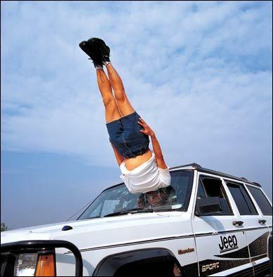 Man falls to car