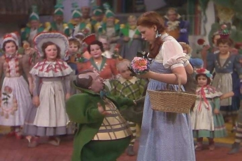 The Wizard of Oz images Dorothy With The Munchkins wallpaper and background photos
