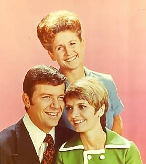 Mike and Carol Brady with Alice