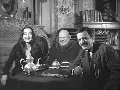 Morticia, Uncle Fester and Gomez