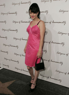 Pauley Perrette wallpaper probably with a cocktail dress and a sign entitled Pauley Perrette