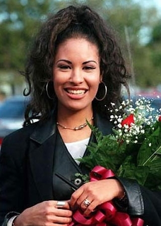 Selena Quintanilla-Pérez wallpaper possibly with a bouquet, a michigan lily, and a portrait called Selena