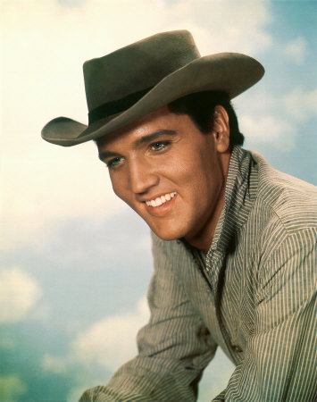 Elvis Presley wallpaper containing a snap brim hat, a campaign hat, and a boater titled Cowboy Elvis