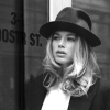 doutzen kroes fotografia probably with a fedora, a business suit, and a dress hat called Doutzen