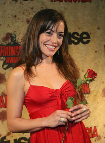 Emmanuelle Vaugier wallpaper probably with a cocktail dress and a bouquet called Emmanuelle