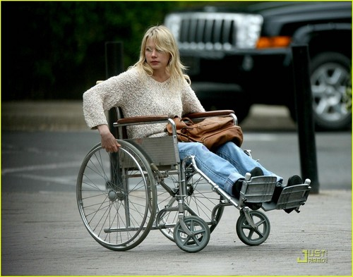 Michelle in a wheelchair on the set of her new film Blue Valentine