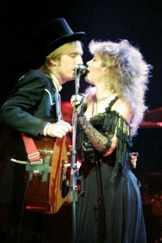 stevie nicks wallpaper containing a show, concerto and a guitarist entitled Stevie Nicks and Tom Petty