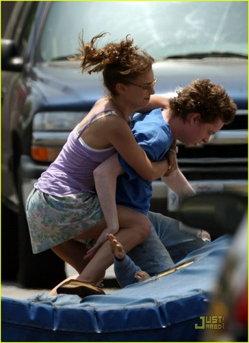 Natalie Portman wrestles one of her costars to the ground