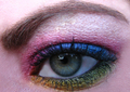 Green eye with rainbow eyeshadow