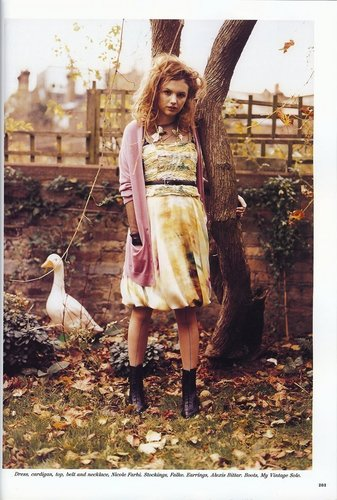 Cassie Ainsworth wallpaper probably with an outhouse, a sign, and a carrier pigeon entitled Hannah Murray , Lulu magazine