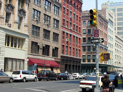 New York wallpaper with a street, a brownstone, and a pelican crossing entitled NY