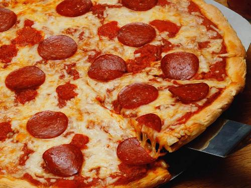 Pizza wallpaper with a pepperoni pizza, a sausage pizza, and a pizza called Pizza Wallpaper
