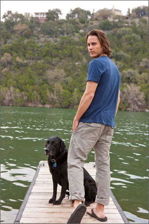 Taylor Kitsch wallpaper probably with a labrador retriever and a chesapeake bay retriever entitled Taylor Kitsch