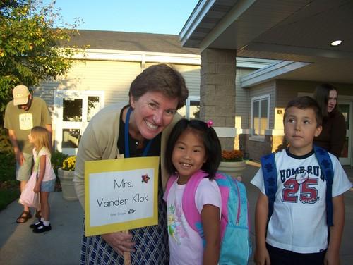 A student with the teacher, Mrs. Vanderklok