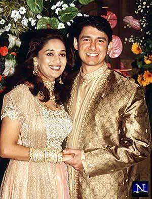 celeb weddings karatasi la kupamba ukuta possibly with a bridesmaid titled Madhuri Dixit's Wedding