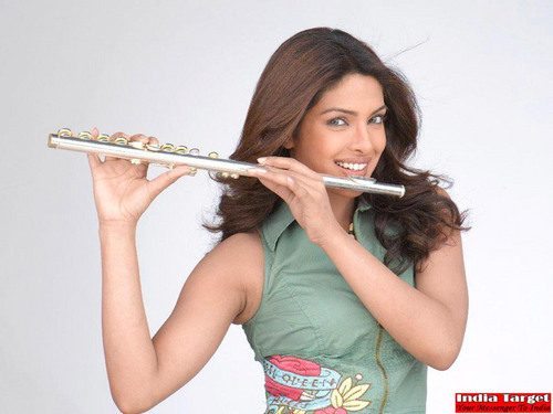 Priyanka Chopra wallpaper containing a flute and a flutist titled Priyanka Chopra