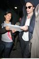 Robert Pattinson arrived at the LAX airpor - twilight-series photo