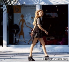 Blake Lively karatasi la kupamba ukuta possibly with hosiery, bare legs, and a hip boot called Teen Vogue