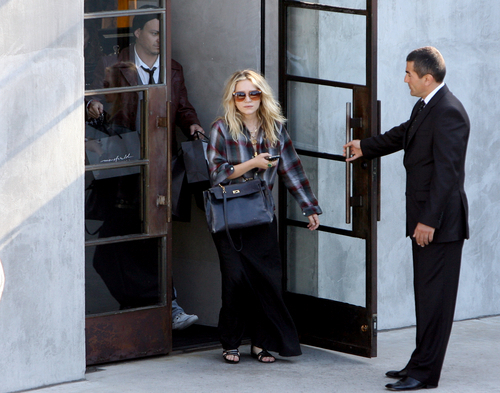 Mary-Kate & Ashley Olsen wallpaper with a revolving door entitled candids
