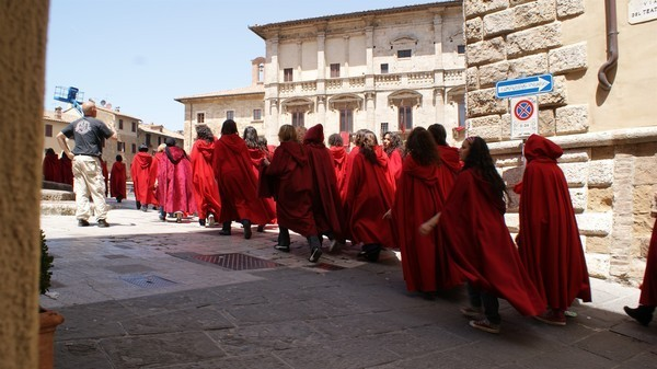 extras marching in on piazza grande