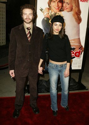 Jackie & Hyde Обои with a business suit entitled mila kunis and danny masterson known as jackie and hyde