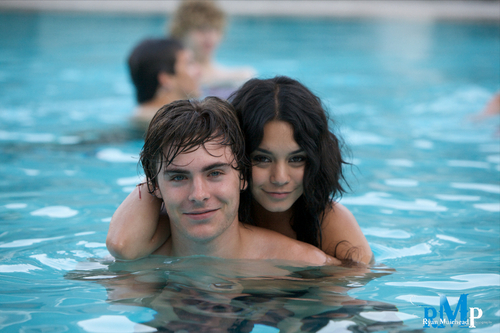 Zac Efron wallpaper with a hot tub, a bather, and a water titled zac efron and vanessa hudgens