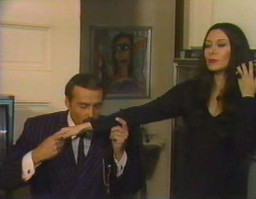 halloween With the New Addams Family - Fake Morticia and Gomez