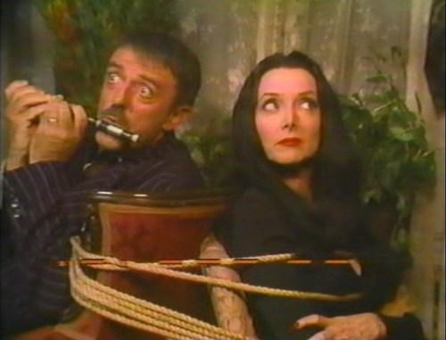 Halloween With the New Addams Family - Tied up with a guy playing the flute...
